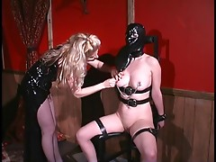 Floozy in mask has her pussy lips clamped