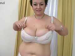 Chubby amateur mother shows off large rack