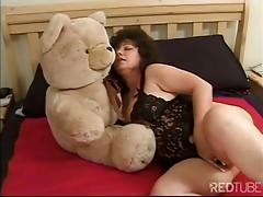 Chubby mature cuddling her teddy