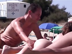 French nudist beach Cap d'Agde wet cracks fingering + oral-stimulation