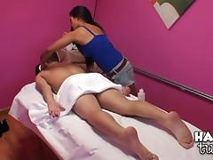 Beautiful Asian masseuse rides a client's big cock
