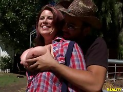 Chubby cowgirl with big tits sucks cock outdoors