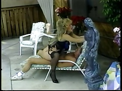 Blonde slut in stockings and stilettos