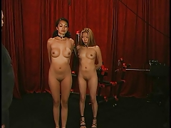Tiny Asain girls get their nipples bound and clamped together.