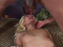 SEXY BLONDE SLUT CHOKES AND GAGS ON A MASSIVE ROD