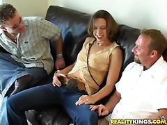Slutty bitch takes on two hard dicks