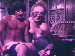 Two hot girls banged by Holmes in vintage porn scene