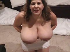 Hot MILF pumping milk from her tits