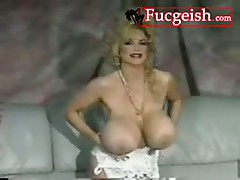 Classy Retro Babe Spreads And Rubs Her Massive Boobs Video