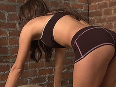 Brunette doll Celeste Star masturbates after her daily workout