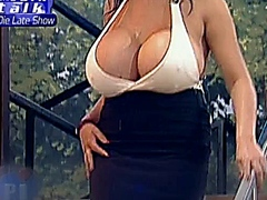 Angelique Dos Santos shows off her massive bubble tits at talk show