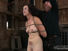 Wanton brunette mature whore gets her tits squeezed hard with metal pegs