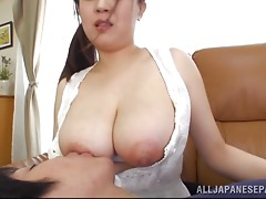 Busty Japanese milf loves getting her big melons licked