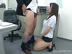 Lustful secretary in high heels sucks off her coworker