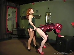 Hot Femdom scene along models playing slave and pegging using strap on