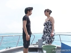 Japanese babe on a fishing boat lets him rub on her curvy body