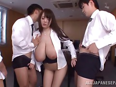 Coworkers enjoy the gigantic natural tits of a Japanese slut
