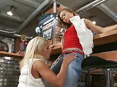 Glorious lesbians pleasuring each other with a golden dildo
