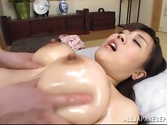 Big tits Asian honey enjoys an erotic massage session