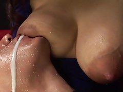 Lactating Japanese girl breastfeeds a guy and makes a mess of his face
