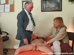 Brunette seduced in threesome with mature female and old stud in office