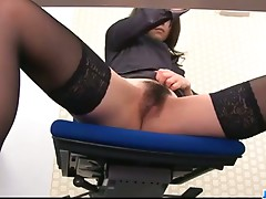 Office bimbo, Maki Hojo, plays with her fann