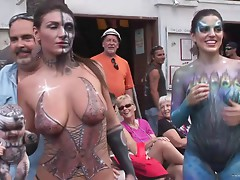 Funny amateur damsel showcasing her big tits and nice ass in a reality street party outdoor