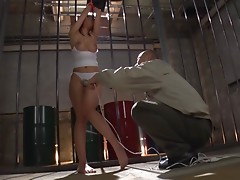 She is tied up and has her hairy snatch toyed with a vibrator