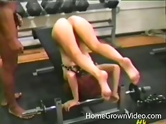 Strange couple hit the gym together then fuck with a strap on in POV