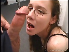 Brunette with glasses licking and sucking her boyfriend's big cock