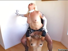 Blonde sex slave with a sexy tattooed body being tortured and fucked by strangers