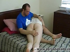 Thong-clad brunette with a chubby body being spanked by her boyfriend