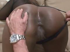Two chubby black whores suck on a hard white pecker