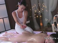 Nude oiled brunette gets massaged
