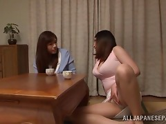 Horny Japanese lesbians have a double ended dildo taking care of their pussies