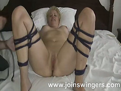 Undressed and roped mature lady