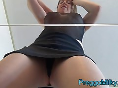 lactating milf squirtting milk on a glass table