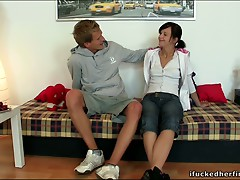 Excited leggy raven haired slut Natalia undresses and lets fellow engulf her boobies