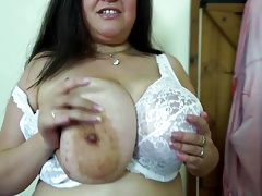 Older mother with large wet billibongs and slit