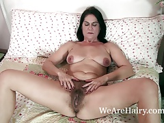 The hot and aged MILF Kaysy disrobes in sofa