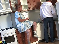 Bushy aged lady receives drilled in the kitchen