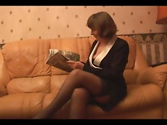 Unshaved Grandmother in nylons plays with pants then undresses