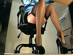 Underdesk tease showing stockings over nylons  -