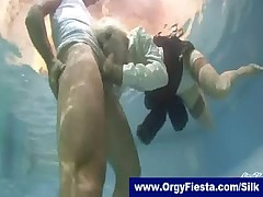 Fully clothed fucksome in a swimming pool -