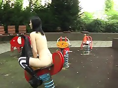 Goth girl gets naked on an public playground