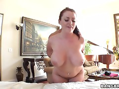 Busty Redhead Rides Her Masseuse's Hard Cock