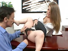 Midget boss Mini Mya is interviewing for a new sexatary, and she makes her interviewees go through a rigorous application process. She sits on her desk and tugs her panties aside so her applicant can eat out her bald pussy, and she drops to her knees to s