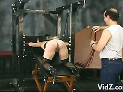 These two a mature bitch and her old Master are both having a wonderful time experimenting with sadomasochism. This slut's hands are tied at her back then put on a cage while their master give instruction to her. They are being told that she has to reach
