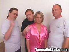 Blonde babe on bukkake gangbang party