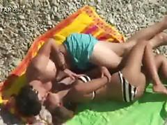 Teen couple fucking on the beach
